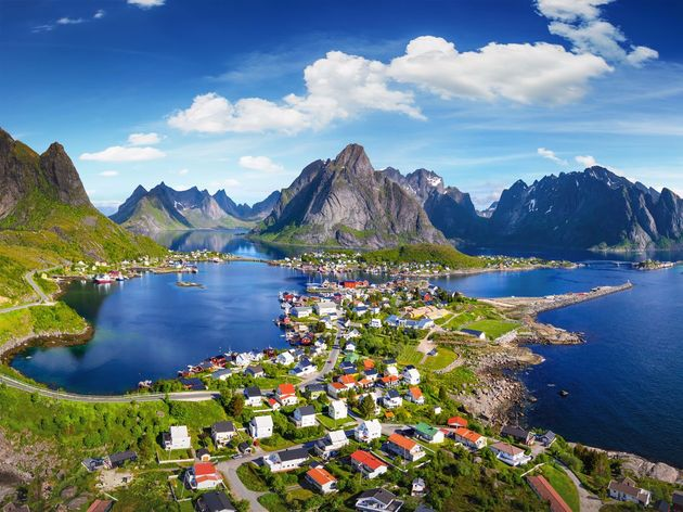 reine-located-in-the-lofoten-archipelago-of-norway-is-a-small-fishing-village-where-youll-find-stunning-scenery-beaches-and-incredible-views-of-the-northern-lights-activities-include-hiking-kayaking-and-of-course-fishing