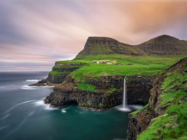 located-at-the-edge-of-a-tall-cliff-overlooking-the-ocean-in-the-faroe-islands-the-village-of-gsadalur-was-immensely-difficult-to-access-until-a-tunnel-was-created-back-in-2004-now-adventurers-who-come-here-can-enjoy-the-unforgettable-landscape-it-bo